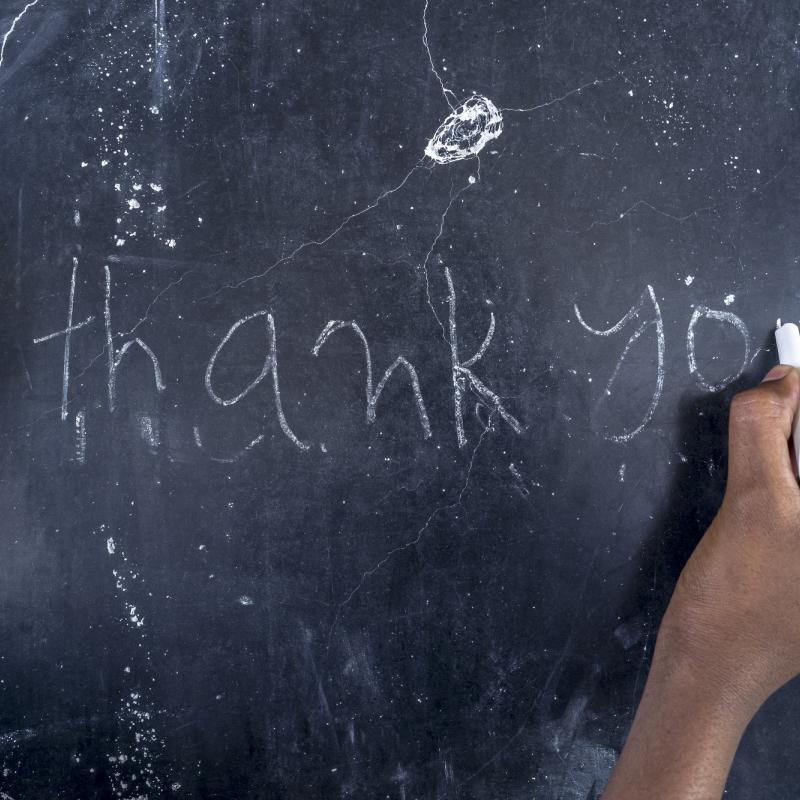 A student draws on a blackboard in Nepal.
