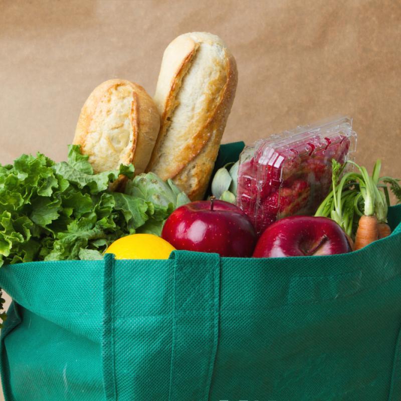 Grocery bag full of fruit and veg