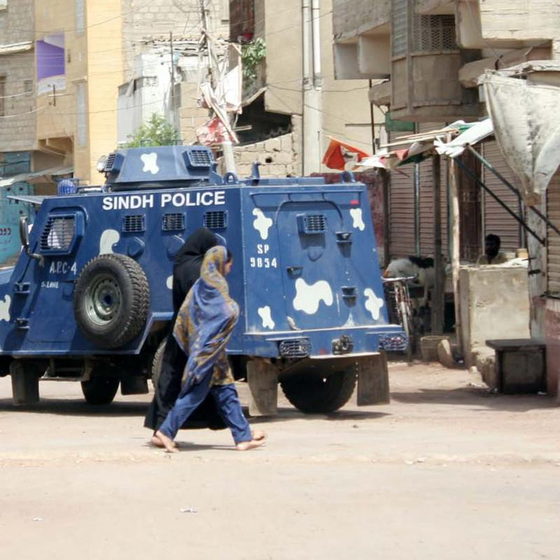 A police vehicle stops in a neighbourhood in Karachi, Pakistan
