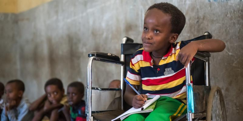 A young boy in a wheelchair listens attentively in class in the Benishangul-Gumuz region of Ethiopia