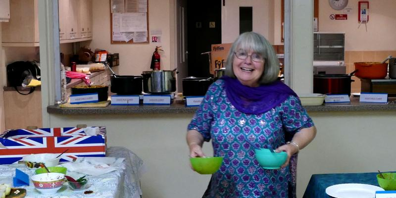 Guildford supporter groups member Anita cooks up a storm at their curry fundraiser
