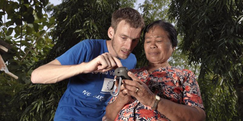 volunteer Arnoud Keizer teaches Anita Ayuban how to use a GPS mapping device
