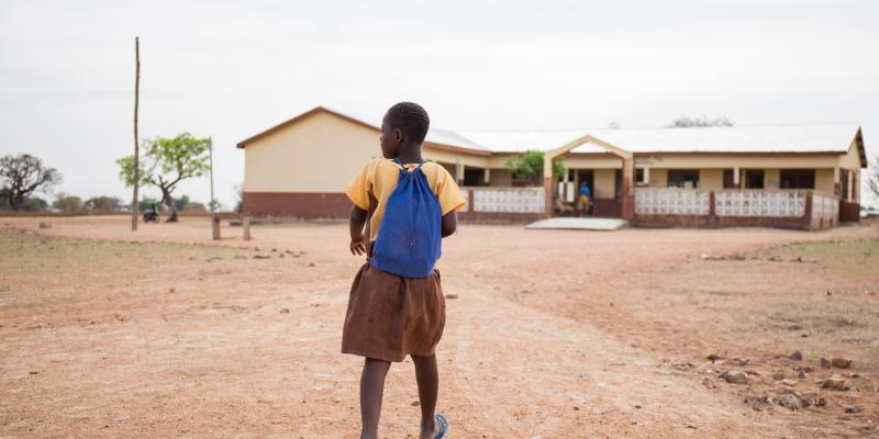 Blessing a girl with down syndrome walks to school in Ghana