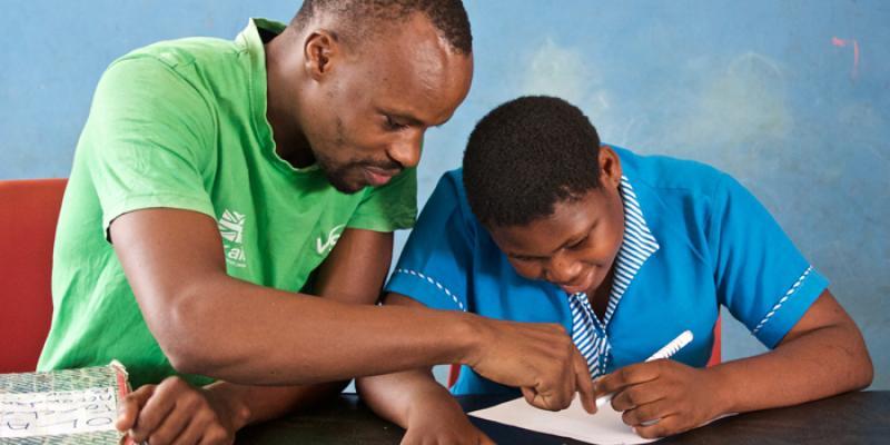 VSO volunteer Gilbert Niwagaba and student Priscilla in Ghana