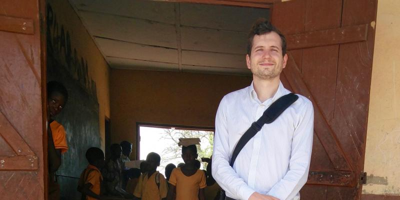 VSO volunteer Tom Legge outside a classroom in Ghana