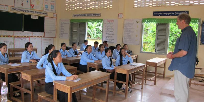 Volunteer Wim visits a classroom in Cambodia
