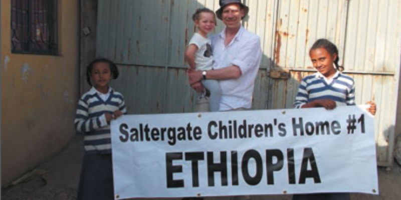 Kevin Morley and daughter Elsa outside the Saltergate Children's Home with two local children