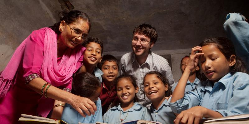 Teacher Bishnu Maya bhandrai , Prinsi, VSO volunteer Gareth and the class