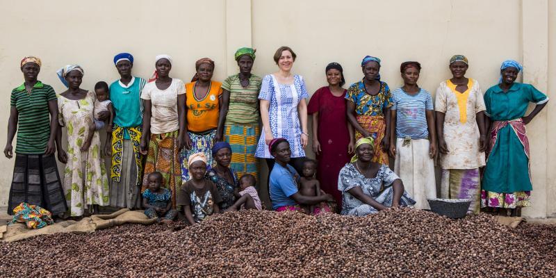 Volunteer Stephanie with women Shea nut processors in Ghana