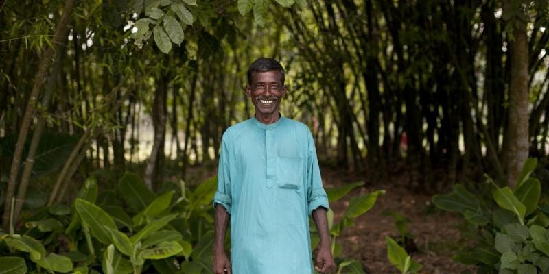 Abdul Latif, pictured here standing outdoors, is a farmer working with VSO on the Growing Together project.