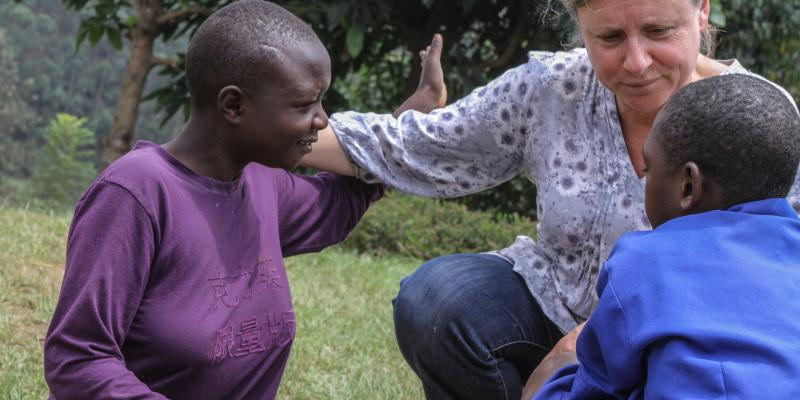 Sifa, 14 years old, with VSO volunteer Jo Doyne, working as a SEN specialist in conjunction with Rwanda Aid