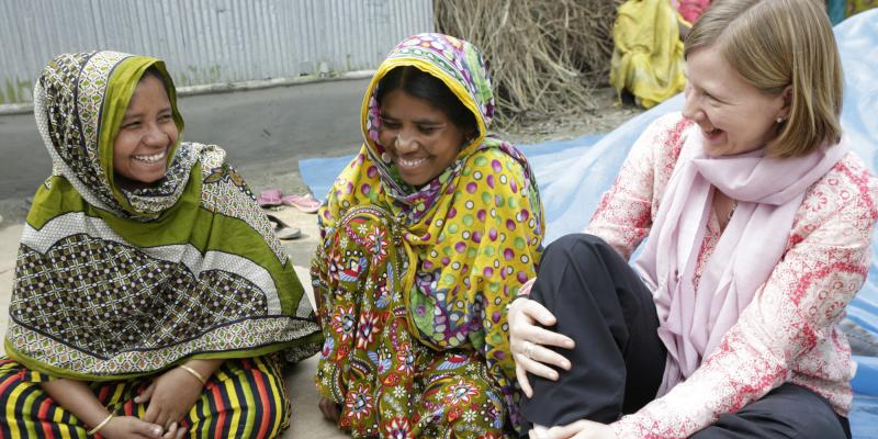 Syngenta's Amanda Scott speaks with members of a women farmers' group in Bangladesh