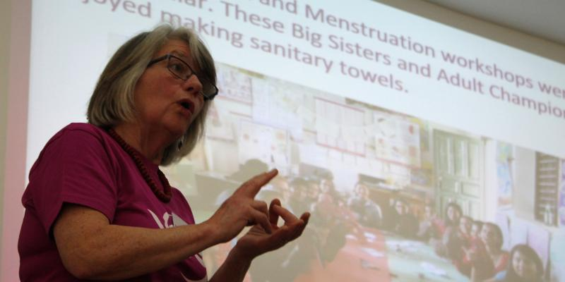 Former volunteer gives a talk at a community event.