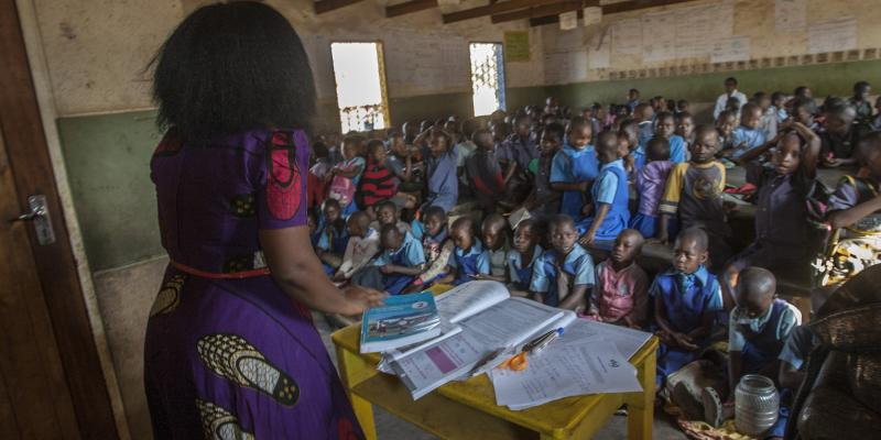 Teacher with a large class size in Malawi