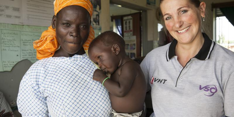 Marianne Bontenbal VSO volunteer midwife regularly works at Awach clinic and here assists with the mother and child health check clinic.