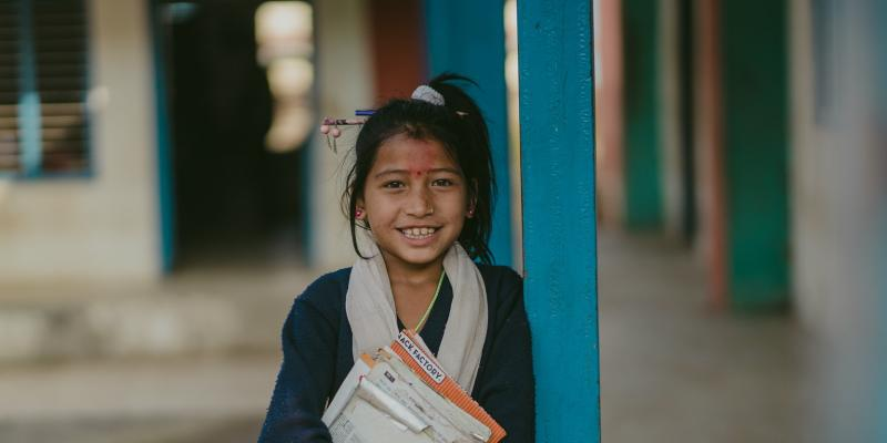 A young Nepalese girl with her school books