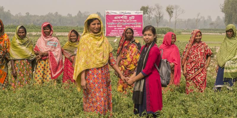 VSO Bangladesh volunteer Nowrin is pictured with the member of an all-women farming collective at Bhelarpara, Birampur, in Dinajpurpur, northern Bangladesh