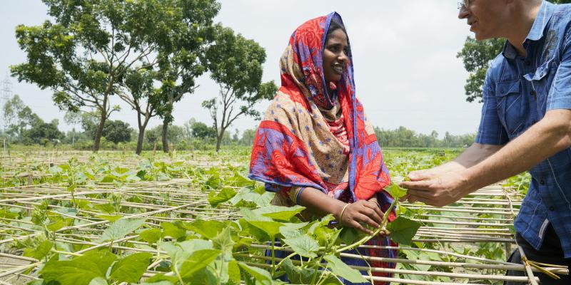 Chuhor Women in Agriculture Pilot group shows cucumber plants to Christophe Bousquet