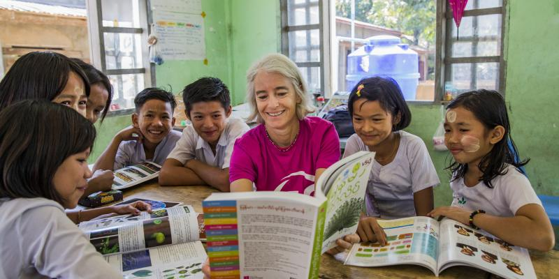 Ana Paula Pinto reads textbook and performs in classroom activity with the students from primary school at Kyakathone primary school, Kyike Ma Yaw township, Mon state on 5 December,2019.