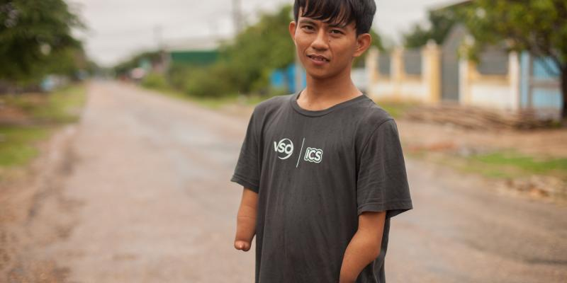 Cambodian volunteer Khe Ouk has a disability - but isn't letting it stop him