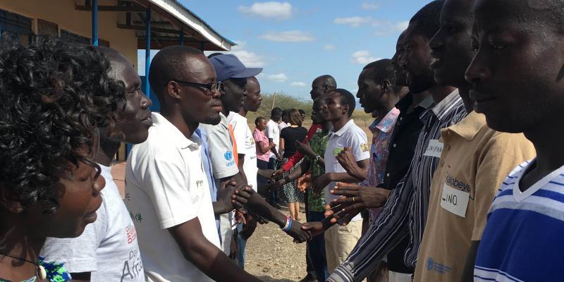 Teachers hold hands during teacher training at Kakuma refugee camp.