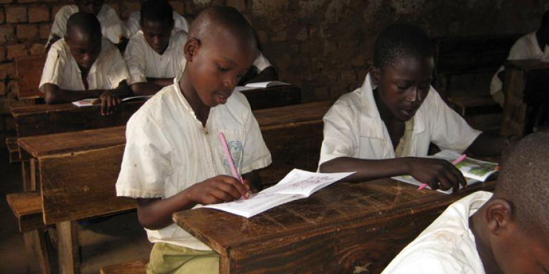 Children reading in a classroom in north west Tanzania