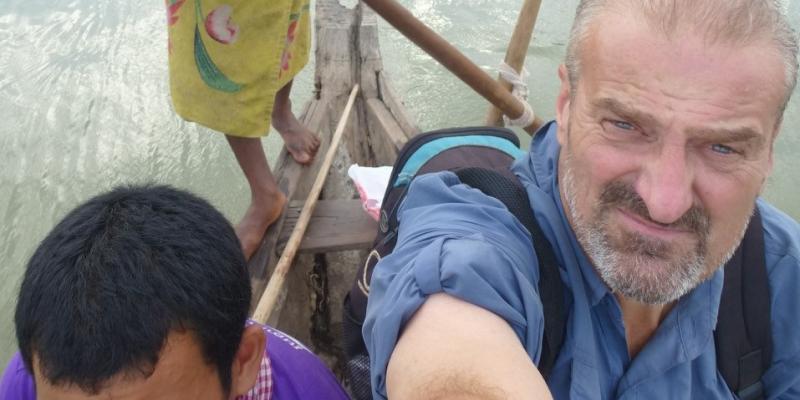 Volunteer Matt Evans takes a boat ride in Cambodia