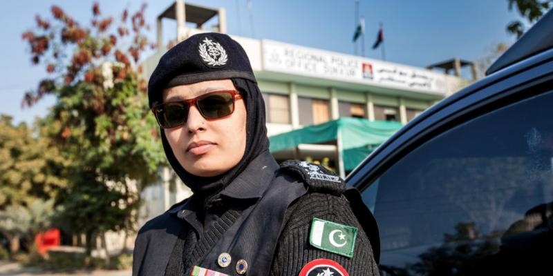A female officer outside a regional police station