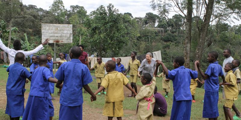 Jo Doyne playing with children from Ngwino Nawe village,