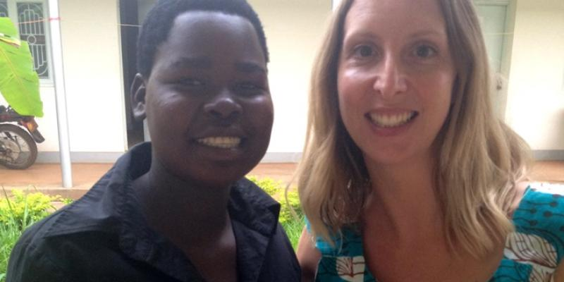 Volunteer Samantha and bricklaying graduate Brenda in Uganda | VSO