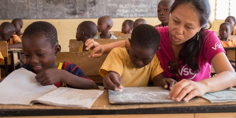 7-year-old Blessing Asokiyine (centre) is helped out by VSO volunteer Mary Carnable during a lesson at Goriko kindergarten in Talensi District