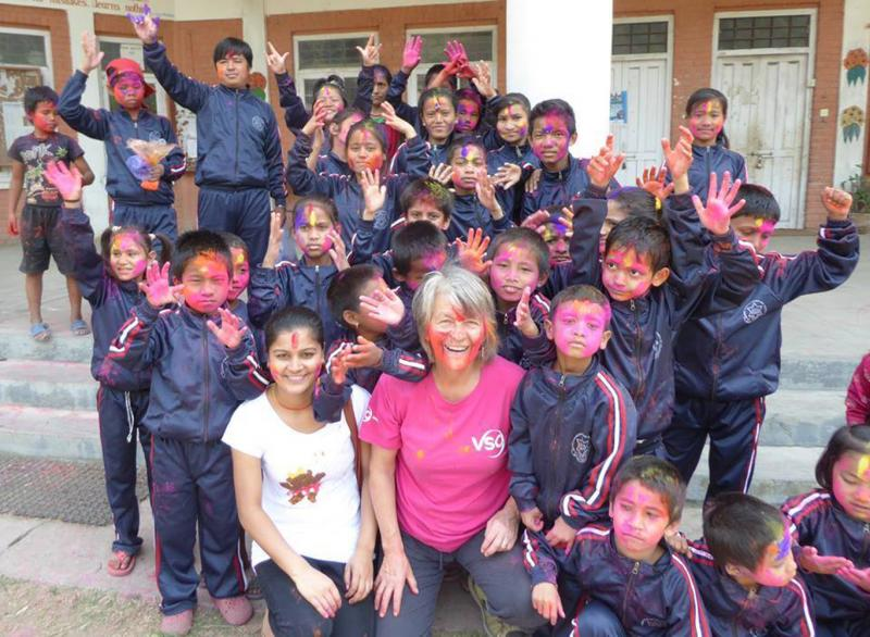 Education volunteer Judith taking part in Holi celebrations in Nepal.