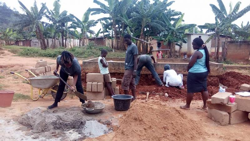 ICS volunteers construct a well in Ghana