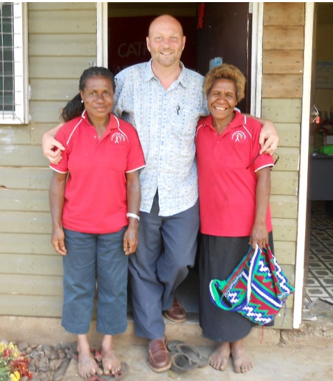 VSO volunteer Charlie with community group members in PNG