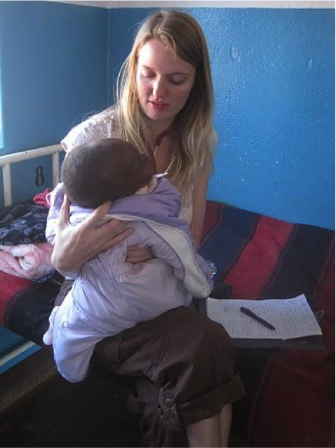 Volunteer Eileen Parks treats a child in a hospital in Zambia