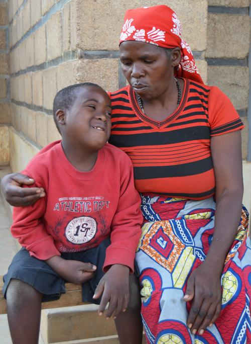 Charles and his mother in Rwanda | VSO