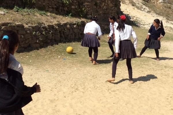 Girls playing football at school in nepal