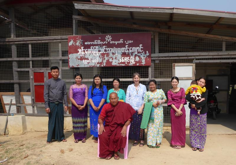 Gwen Harris visiting a school, with the monk co-founder and teachers who have donated to the school.