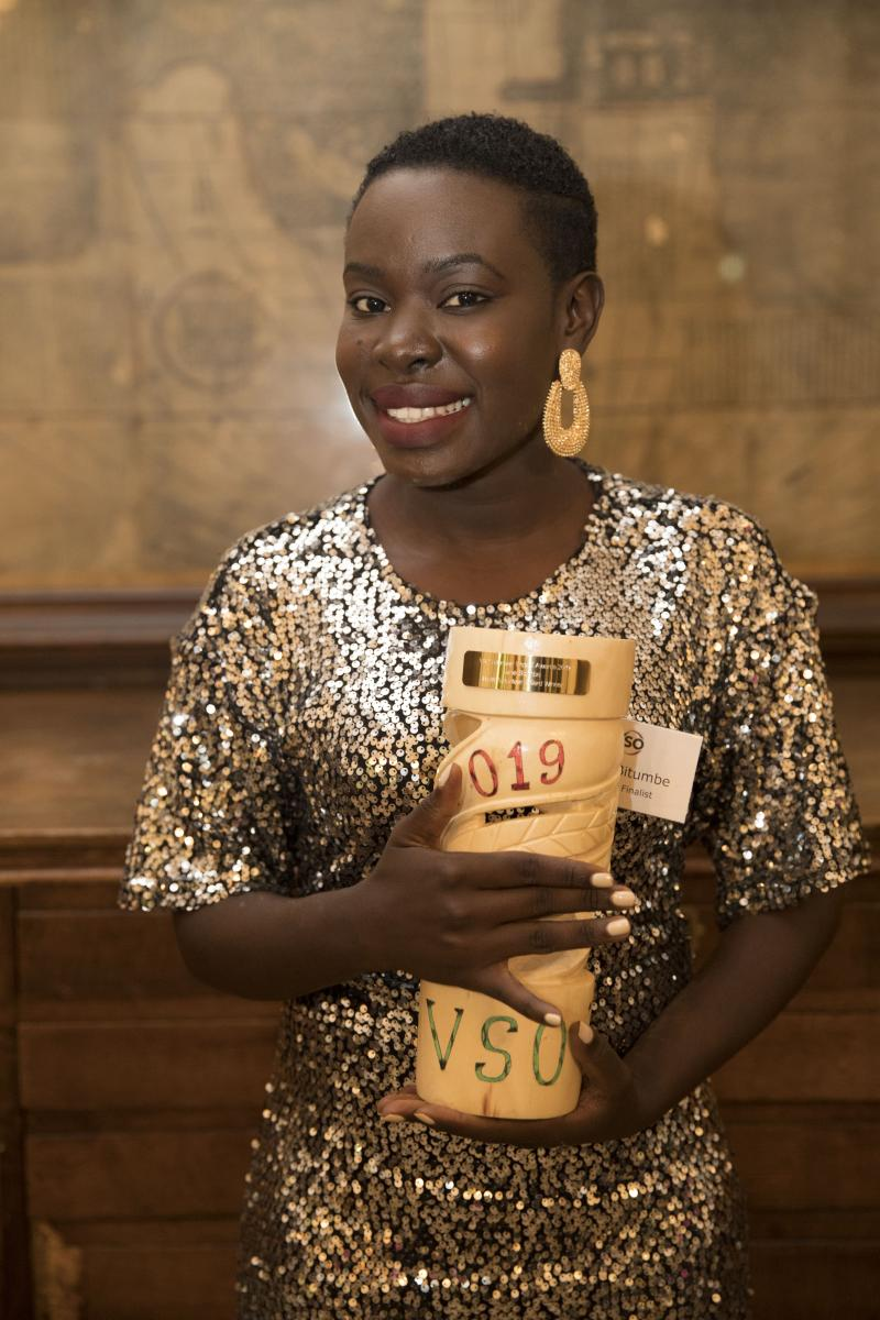 Irene Bitumbe with her trophy at VSO's Volunteer Impact Awards