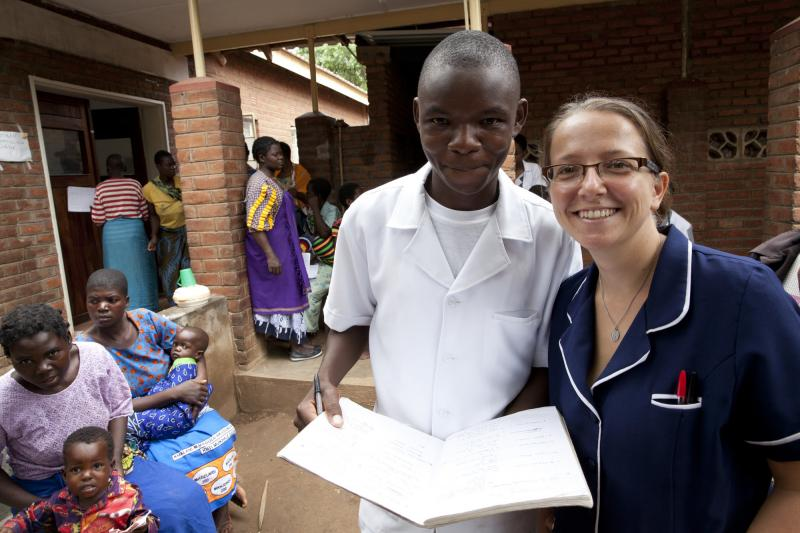 Briony Jenkins, Paediatric Nurse trainer on a VSO THET placement working with one of her students, Pearson Makove