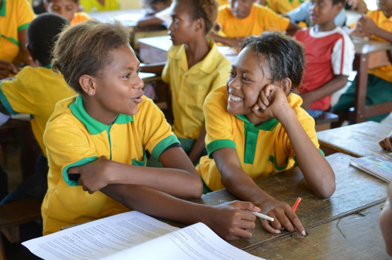 Two girls at Kusbau primary school in Madang discussing a text in a language lesson.