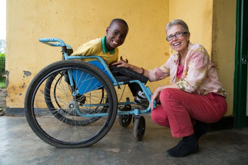 VSO volunteer Christiane Merz together with Celebral Palsy sufferer seven year old Samuel Bangamwabo