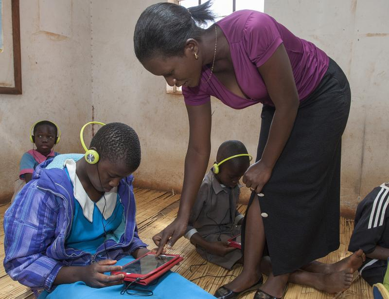 Teacher and pupils using tablet edutech technology in the classroom in Lilongwe Malawi | VSO