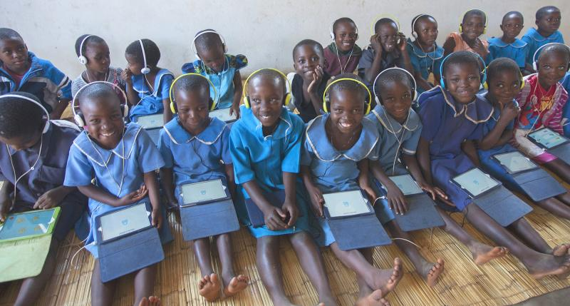 Children using tablet computers in a Malawi classroom | VSO