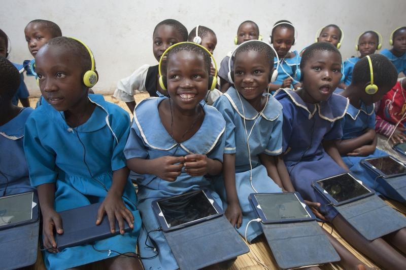 Standard-two pupils, Juliet Chisi, left, Lezina Gamaliel, Jessie Mbewe and Gloria Mphalo smile during the Unlocking Talent Through Technology class session at Ngwenya Primary School in Lilongwe Urban District Education Office