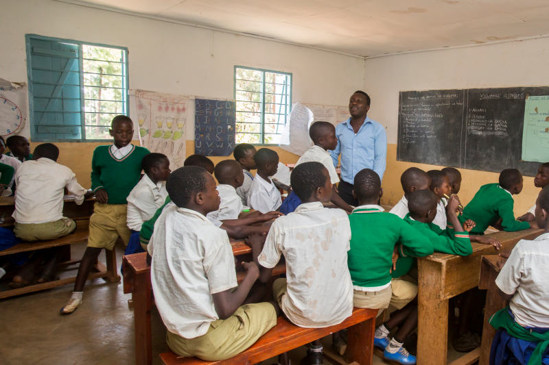 A teacher in Tanzania addresses his classroom