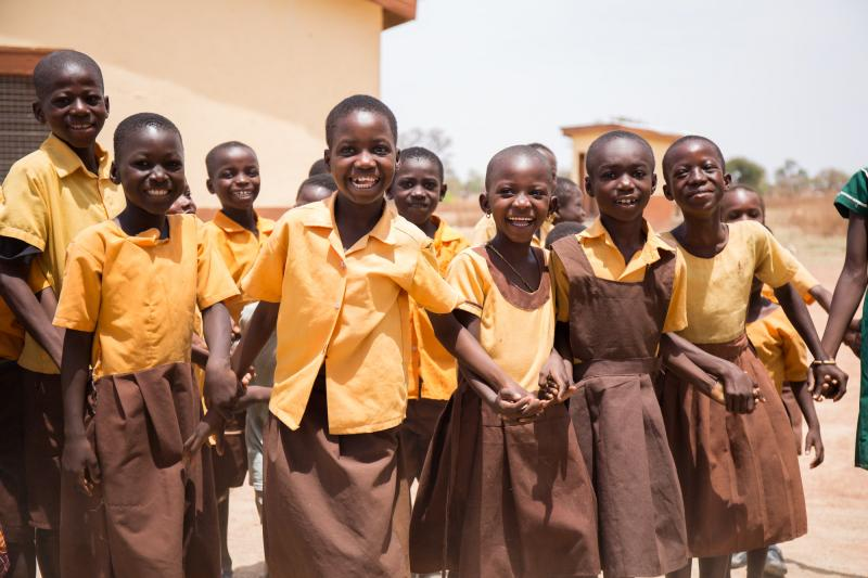 Students holding hands in the yard at Goriko school, Talensi, Ghana