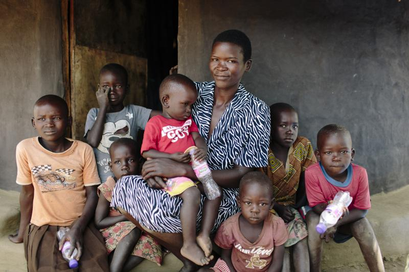 Young farmer Christine with children in Uganda