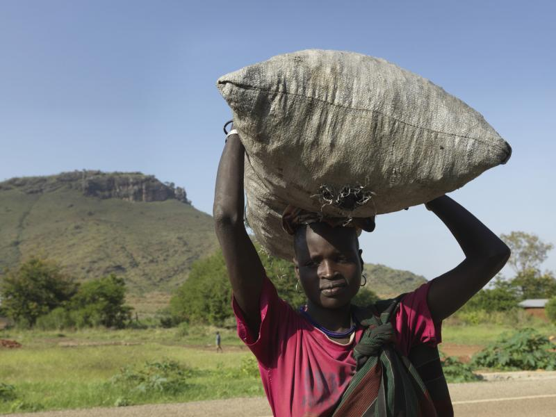 Girl selling charcoal in Karamoja Uganda