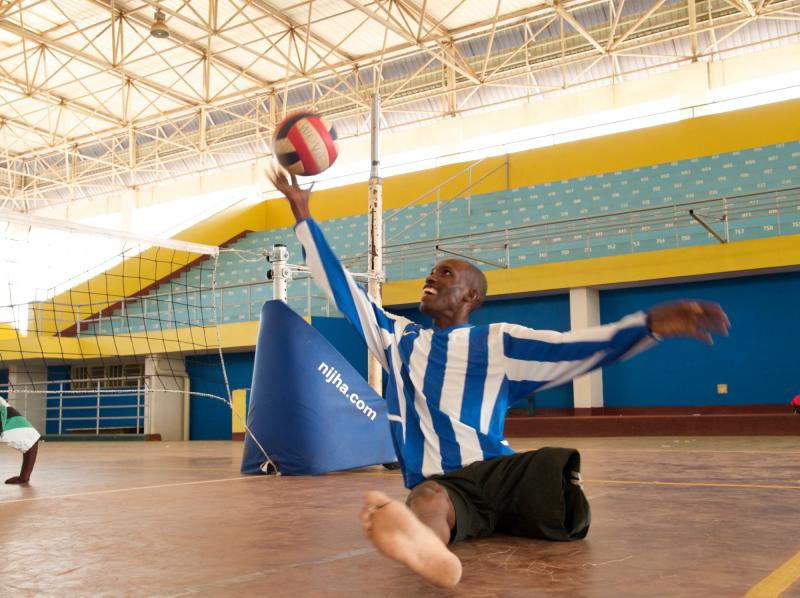 Rwanda National Paralympic Committee member playing seated volleyball